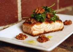 Candied walnut butter is served atop tasty salmon for a show-stopping meal!