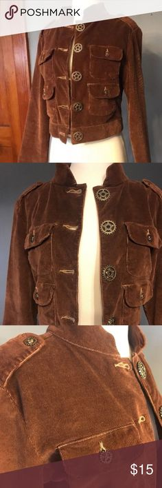 "Brown Corduroy Steampunk Button Cropped Jacket SM Gently worn Stars Jeans brand corduroy jacket. Colour is rich coffee brown. Cropped and lightweight jacket, fitted with large decorative buttons down front. The 4 front pockets, and shoulders, have smaller gear buttons, lending a steampunk vibe. Four decorative buttons added to back waistband.  Juniors SMALL. Measurements approximate, taken with garment lying flat, in inches.  Chest (pit to pit) 36"" Waist(waistband) 32"" Length (shoulder to…"