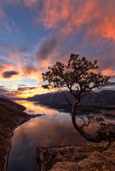 Slow Burning - As always this looks best on black background. This is a reprocessed version of this image. I have calibrated my monitor since I posted this one the first time so I had to repost it, and in my opinion it looks alot better now. This is a view over Sunndalsfjorden in Sunndal county during sunset in May last year. Thanks for watching.
