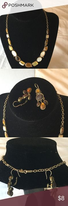 "COSTUME NECKLACE/EARRINGS SET This gold chain necklace has cream/ gold/brown round & squares and rectangular shape iridescent stones. Earrings have a snap back are brown/gold. Necklace hangs down 9"" Charming Charlie Jewelry Necklaces"