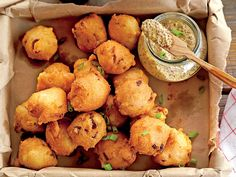 Crispy Andouille Hush Puppies | This crunchy, savory bite is a delicious dockside starter.
