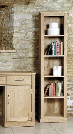 this mobel oak narrow bookcase is the perfect way to create storage in small and awkward alcove areas with its tall and slim design