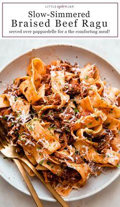 Braised Beef Ragu - homemade beef ragu served over pappardelle pasta - the perfect Sunday supper! #beefragu #pastarecipes #ragu #dinnerideas #sundaysuppers | Littlespicejar.com