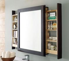 A clever bath mirror with side pull out shelves that let users access items without interrupting their looking glass view.