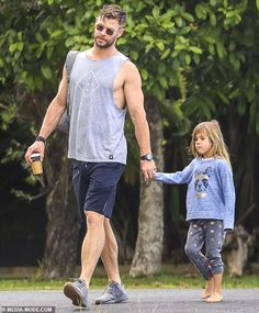 Hands-on father: Chris Hemsworth, showed off his bulging biceps in a grey muscle tank,. Chris Hemsworth Thor, Film Star Trek, Star Wars, Snowwhite And The Huntsman, Hemsworth Brothers, Hot Dads, Photography Poses For Men, Marvel, Handsome Actors