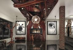 globe antler chandelier with large wooden fireplace. fossil sculptures, interiors. Shawn Rivett Designs