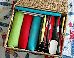 Car organization. Uses pouches for commonly used items like emergency meds, trays for kids to eat snacks, blankets. Scroll down to take a look at how clean her car looks!