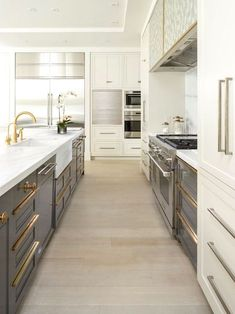 Love this two-toned kitchen! The white softens the gray.