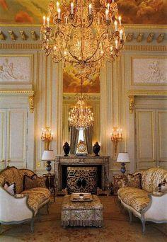 Louis XVI paneled room with Louis XV sofas.