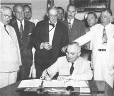 The North Atlantic Treaty Organization (NATO) was formed in 1949 to protect Western Europe from Soviet aggression. It was countered in 1955 by the Warsaw Pact, formed by the Soviet Union and its European satellites. Shown here is President Truman signing the treaty that created NATO.