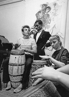 James Dean the Giant playing a conga drum