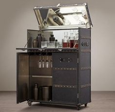 Storage Furniture - This bar cabinet is solidly built, clad in leather and edged all around with scores of brass nailheads hammered by hand.