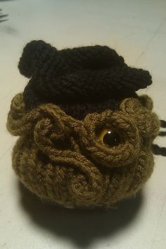 Also on my favorites in Ravelry. Cthulhu dice bag! :)  http://www.ravelry.com/patterns/library/dice-bag-of-doom