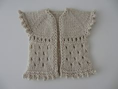 FREE new born  baby cardigan pattern by Henriette Roued-Cunliffe