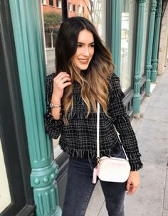 A tweed top with skinny jeans, a crossbody bag, and delicate jewelry.