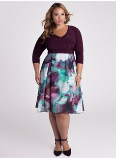 Time for color and feminine style with this purple plus size dress with a flowing A line skirt!