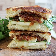 This decadent grilled cheese is made with brie, arugula, sliced pear, and homemade bacon jam.