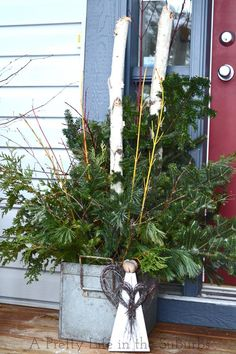 Sweet & Natural Christmas Planters with rustic angel. A Pretty Life in the Suburbs.