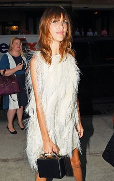 Alexa Chung stuns in a feather-embellished dress + small boxy clutch