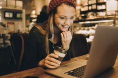 Photo of a young woman using laptop in a coffee shop Keynote Speakers, Book Publishing, Coffee Shop, Judith, Events, News, Twitter, Blog, Writing Tips