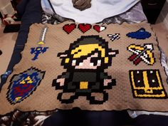 Legend of Zelda blanket. Corner to corner crochet. I made three panels and stitched them together. As a first try, I think it turned out well but there are things I could do better.