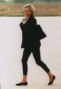 ofvogueandrestraint: Princess Diana in a navy blue double-breasted blazer, blue shirt and black trousers with flats.