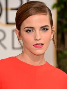 Emma Watson opted for a sleek side-part and matte coral pink lips | 2014 Golden Globes