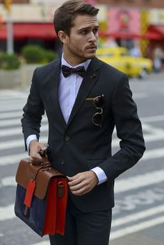 Live the leather bag, bow tie, and jacket cut on the blazer. Not to mention the awesome leather briefcase. Check out more on www.hunterandsons.com.