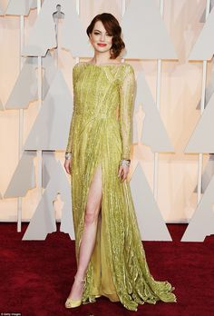Emma Stone wore a heavily-embellished gown by Elie Saab Haute Couture and Tiffany and Co. Jewels to the Oscars 2015.