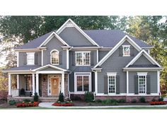 Floor Plan AFLFPW08637 is a beautiful 3054 square foot New American home design with 2 Garage Bays