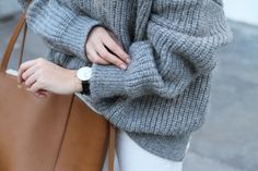 Closed knit, Céline cabas bag and Larsson & Jennings watch. Via Mija