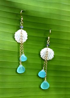 Noelani Designs: Faceted blue and seagreen chalcedony teardrops sparkle and dangle playfully on chains from a white mother of pearl clam shell.