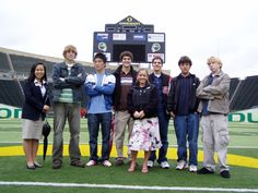 "A group of students on campus at the University of Oregon at our ""University of Oregon Sports Marketing Conference"" on the field at Autzen Stadium as part of their behind-the-scenes tour of the Ducks' athletic facilities"