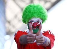 Editorial use only. No merchandising. For Football images FA and Premier League restrictions apply inc. no internet/mobile usage without FAPL license - for details contact Football Dataco Mandatory Credit: Photo by Kieran McManus/BPI/REX/Shutterstock (5746728c) A Wales fan ahead of the UEFA Euro 2016 Semi Final match between Portugal and Wales played at the Stade de Lyon, Lyon, France on July 6th 2016 Football - UEFA European Championships 2016 Semi Finals Portugal v Wales Parc Olympique…