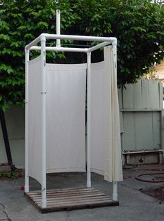 Camping Shower - Camp shower made with pvc pipes. Hang camp shower bladder on the tall pole at the top. www.amazon.com/...