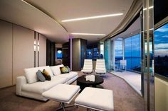 http://keepmihome.com/wp-content/uploads/2014/10/modern-home-interior-design-with-white-sofa-set-and-black-wooden-round-table-and-twin-lounge-chair-as-well-glass-wall-along-with-lighting-idea-in-ceiling-801x534.jpg
