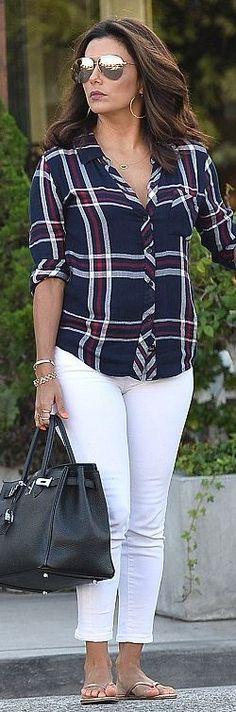 Who made  Eva Longoria's black tote handbag, white skinny jeans, and blue plaid shirt?