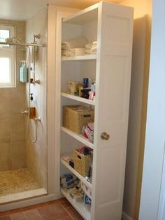 Pull-out bathroom storage behind the shower plumbing wall. All that storage and easy access to the plumbing when you need it! What a great idea for a Tiny House or any house!!