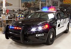 """Ford Police Interceptors"". ...  now this - THIS is the car I want! Heck with the crown vic...impala...caprice...and charger...I'd even take this over the tahoe! Well. Maybe not. Lol"