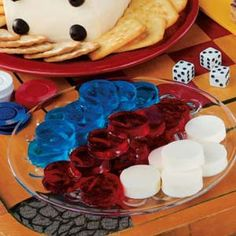 Gelatin Game Chips...It's a safe bet these gelatin gems will delight a full house of friends. The white ones have a creamy vanilla taste while the others are sweet and fruity.