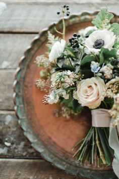 Winter wedding bouquet: http://www.stylemepretty.com/montana-weddings/coram/2014/10/01/winter-wedding-inspiration-at-green-valley-ranch/ | Photography: Rebecca Hollis - http://rebeccahollis.com/