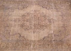 8x11 Distressed over dyed rug at Nomad Rugs