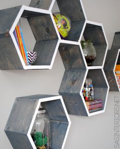 Boy Bedroom  - Gray walls, pops of orange & blue and these honey comb shelves.