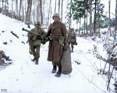 1st Platoon, Company B, 101st Combat Engineer Battalion, 26th Infantry Division, after being relieved from their position in the woods before Wiltz, Luxembourg. January 14, 1945