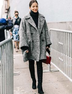 A delightfully oversized coat with cropped sleeves.