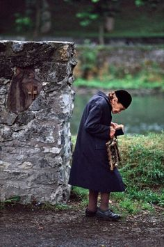 Lourdes, France. Steve McCurry: gorgeous photographs of people reading around the world. | stories are everywhere