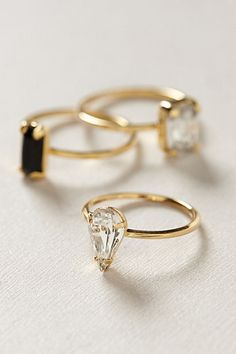 Fancy little rings- love the 'tear drop' shape. Too bad the stone in my first engagement ring was this cut! I'd love another this shape, but out with the old and in with the Trad ;)