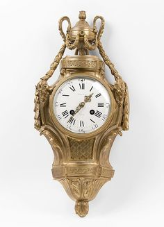Tiffany & Co., late 19th century French Louis XVI Bronze Wall ClockIt features a case surmounted with a classical urn draped in swags with ram's heads flanking the upper dial.