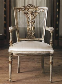 Stunning hand-crafted in Italy Hepplewhite style beech wood armchair with carved leaf motif, distressed white finish and antique gold leaf trim