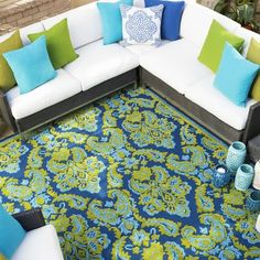 Presenting our new area rug in fabulous color and sculpted design of varied blues and greens, reminiscent of a trip to Italy, Barcelona or a dream vacation in a Mediterranean Isle location! Add these brilliant colors and lux feel to any indoor or outdoor space to create a welcoming, warm room!